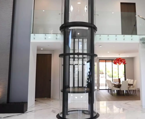 Luxury-marble-foyer-with-Vuelift-round-descending